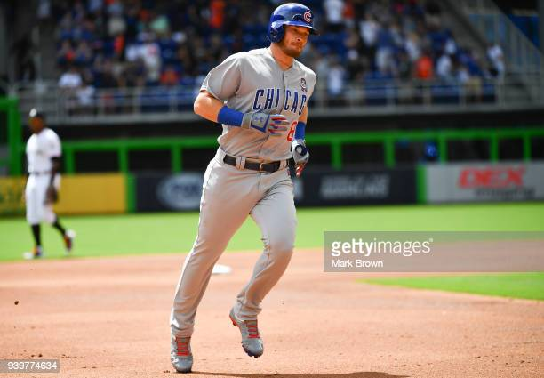 Ian Happ of the Chicago Cubs rounds the bases after hitting a lead off home run off the first pitch in first inning during Opening Day against the...
