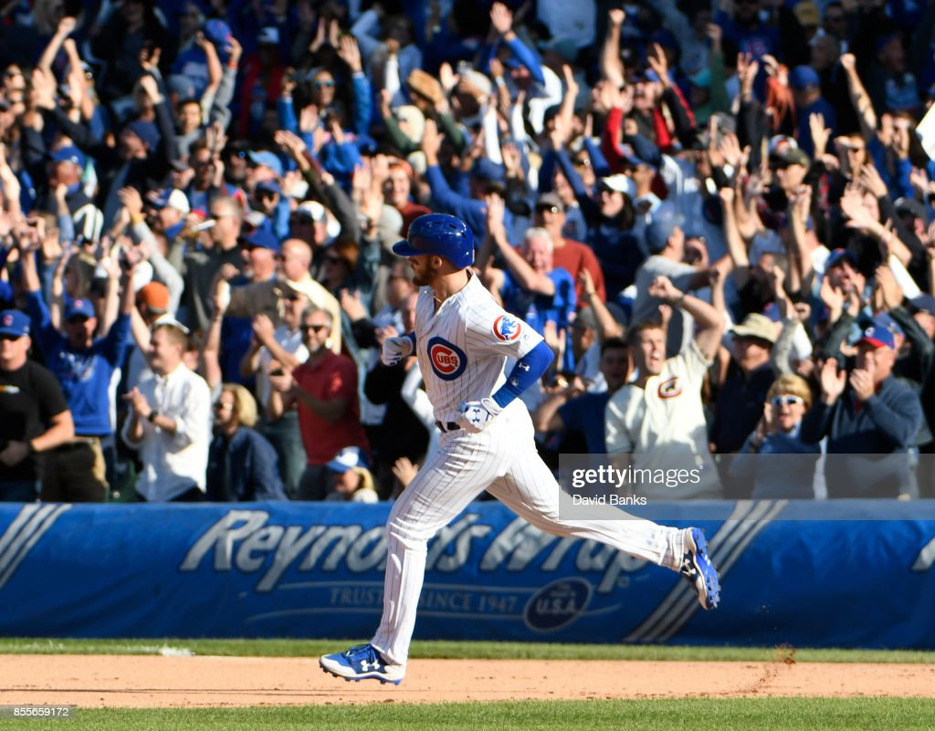 Ian Happ #8 of the Chicago Cubs runs the bases after hitting a three-run homer against the Cincinnati Reds during the eighth inning on September 29, 2017 at Wrigley Field in Chicago, Illinois.