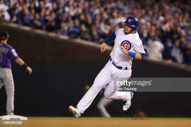 Ian Happ of the Chicago Cubs runs the bases during the National League Wild Card game against the Colorado Rockies at Wrigley Field on Tuesday...