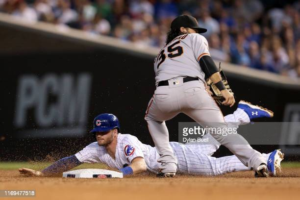 Ian Happ of the Chicago Cubs steals second base past Brandon Crawford of the San Francisco Giants in the second inning at Wrigley Field on August 21...