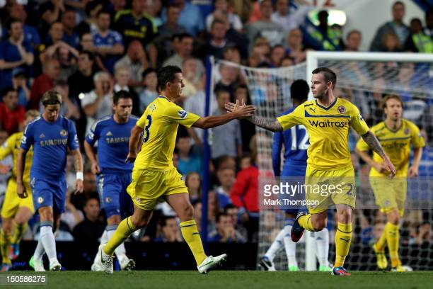 Ian Harte congratulates Danny Guthrie of Reading on scoring their second goal during the Barclays Premier League match between Chelsea and Reading at...