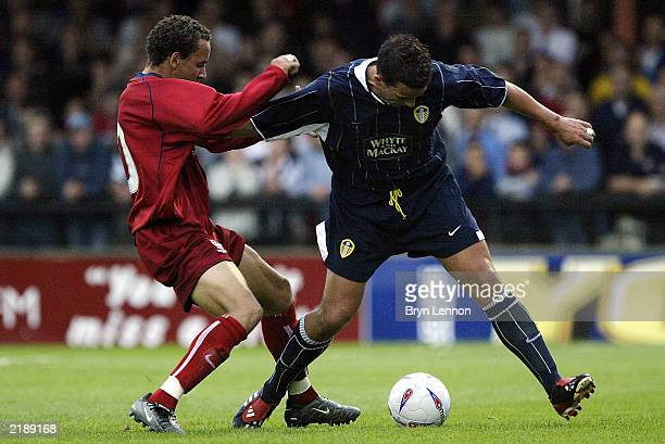 Ian Harte of Leeds United holds off a challenge from Liam George of York City during the preseason friendly between York City and Leeds United at...