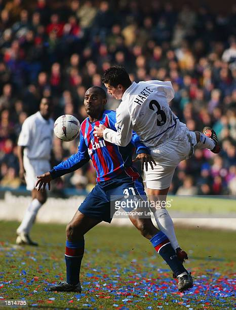 Ian Harte of Leeds United jumps into Dele Adebola of Crystal Palace during the FA Cup fifth round match held on February 16 2003 at Selhurst Park in...