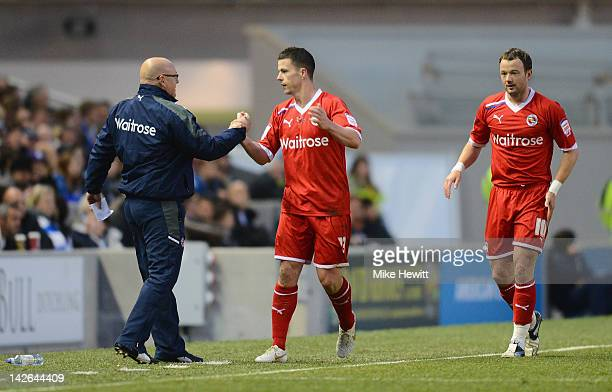 Ian Harte of Reading celebrates with Brian McDermott after scoring the only goal of the game during the npower Championship match between Brighton...
