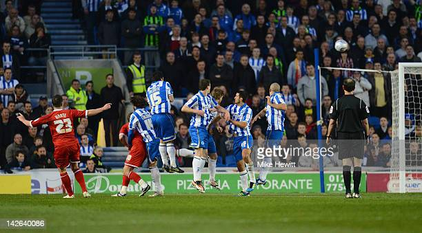 Ian Harte of Reading curls a free kick over the Brighton wall and into the goal during the npower Championship match between Brighton Hove Albion and...