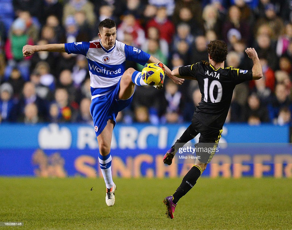 Ian Harte of Reading is challenged by Juan Mata of Chelsea during the Barclays Premier League match between Reading and Chelsea at Madejski Stadium on January 30, 2013 in Reading, England.