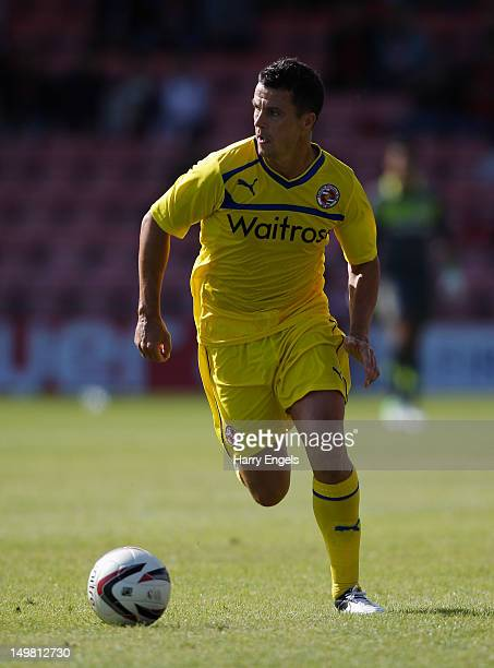Ian Harte of Reading runs with the ball during the preseason friendly match between Bournemouth and Reading at the Goldsands Stadium on August 4 2012...