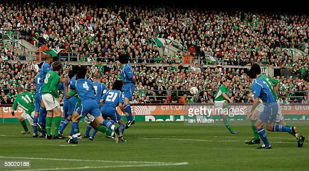 Ian Harte of Republic of Ireland scores the first goal during the Group Four World Cup 2006 qualifying match between Republic of Ireland and Israel...