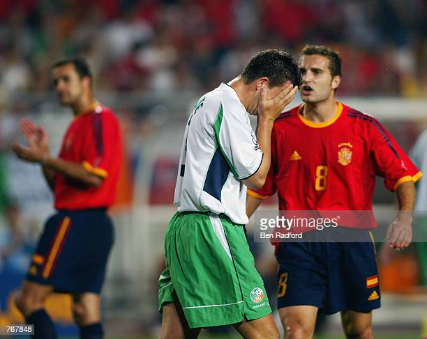 Ian Harte of the Republic of Ireland holds his head in his hands after missing a penalty kick during the FIFA World Cup Finals 2002 Second Round...
