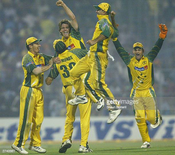 Ian Harvey of Australia celebrates the fall of the last wicket with teammates during the TVS Triangular One Day Series Final between India and...