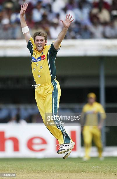 Ian Harvey of Australia celebrates the wicket of Devon Smith of the West Indies during the 1st One Day International between the West Indies and...