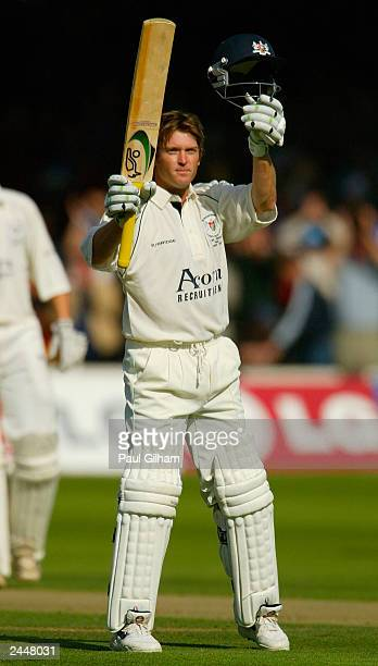 Ian Harvey of Gloucestershire celebrates making fifty runs during the Cheltenham & Gloucester Trophy Final between Gloucestershire and Worcestershire...