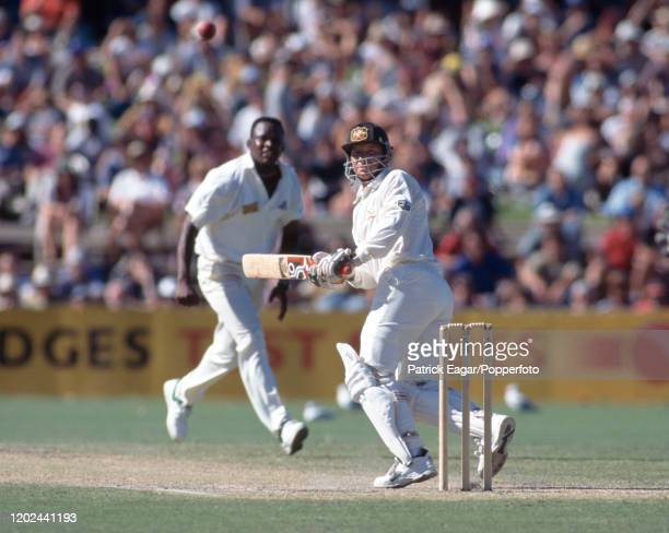 Ian Healy of Australia plays a delivery from Devon Malcolm of England during his innings of 74 runs in the 4th Test match between Australia and...