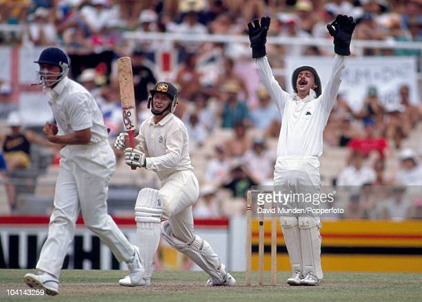 Ian Healy of Australia survives an appeal from England wicketkeeper Jack Russell, and fielder Alec Stewart during the 3rd Test match between...