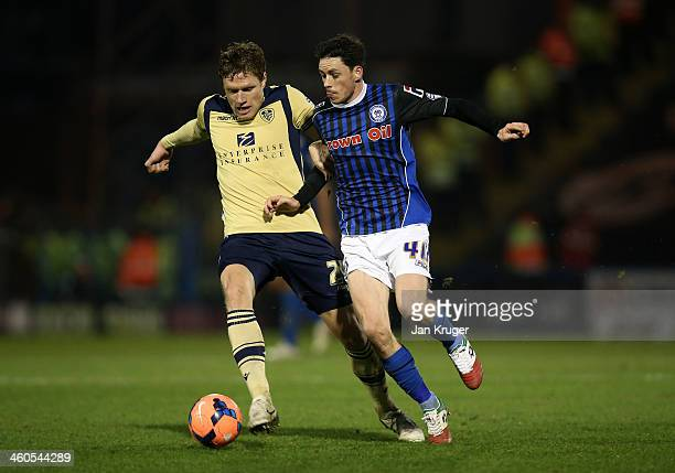 Ian Henderson of Rochdale AFC battles with Marius Zaliukas of Leeds during the Budweiser FA Cup third round match between Rochdale and Leeds United...