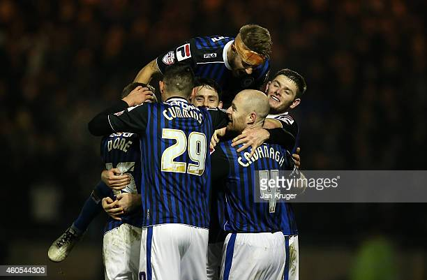 Ian Henderson of Rochdale AFC celebrates his goal and win with teammates during the Budweiser FA Cup third round match between Rochdale and Leeds...