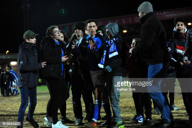 Ian Henderson of Rochdale AFC with fans on the pitch after The Emirates FA Cup Fourth Round match between Rochdale AFC and Millwall at Spotland...
