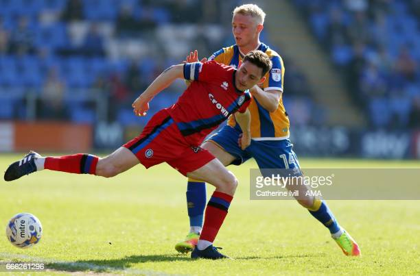 Ian Henderson of Rochdale and Jack Grimmer of Shrewsbury Town during the Sky Bet League One match between Shrewsbury Town and Rochdale at New Meadow...