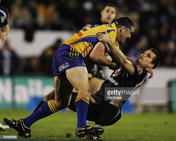Ian Hindmarsh of the Paramatta Eels is tackled by Todd Byrne of the Warriors during the NRL qualifying final match between the Warriors and the...