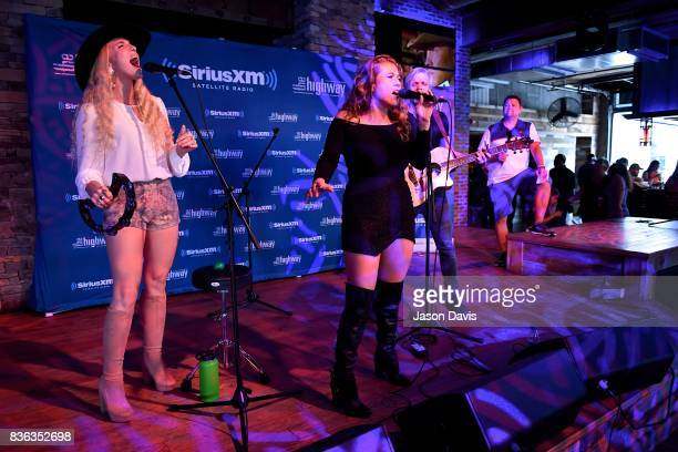 Ian Hljes Elizabeth Hopkins and Brittany Hlljes of Delta Rae perform on stage during SiriusXM The Highway's Live Broadcast of the Solar Eclipse at...