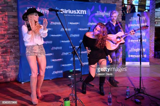 Ian Hljes, Elizabeth Hopkins and Brittany Hlljes of Delta Rae perform on stage during SiriusXM The Highway's Live Broadcast of the Solar Eclipse at...