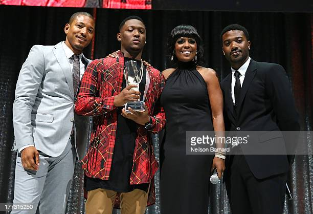 Ian Holder Hitboy BMI Vice President Catherine Brewton and RayJ onstage at the 2013 BMI RB/HipHop Awards at Hammerstein Ballroom on August 22 2013 in...