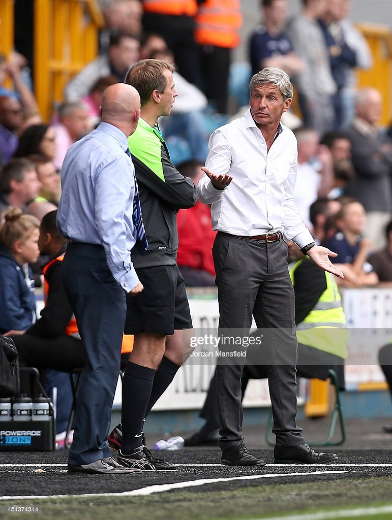 Ian Holloway, Manager of Millwall and Jose Riga, Manager of Blackpool exchange words during the Sky Bet Championship match between Millwall and Blackpool at The Den on August 30, 2014 in London, England.