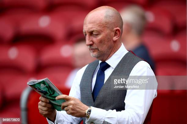 Ian Holloway, manager of QPR reads the matchday programme prior to the Sky Bet Championship match between Brentford and Queens Park Rangers at...
