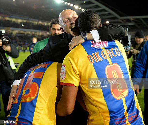 Ian Holloway the Crystal Palace manager celebrates with Kagisho Dikgacoi and Mile Jedinak after winning the npower Championship play off semi final...