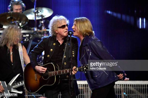 Ian Hunter and inductees Rick Savage and Joe Elliott of Def Leppard perform onstage during the 2019 Rock Roll Hall Of Fame Induction Ceremony Show at...