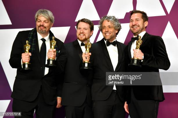 Ian Hunter JD Schwalm Paul Lambert and Tristan Myles winners of Best Visual Effects for 'First Man' pose in the press room during at Hollywood and...