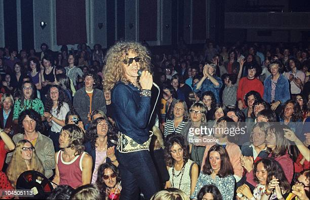 Ian Hunter of Mott The Hoople performs amongst the audience at Birmingham Town Hall on December 26 1970.