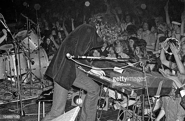 Ian Hunter of Mott The Hoople performs on stage at The Royal Albert Hall playing electric piano in front of a cheering audience in London on July 8...