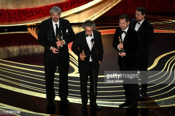 Ian Hunter Paul Lambert J D Schwalm and Tristan Myles accept the Visual Effects award for 'First Man' onstage during the 91st Annual Academy Awards...