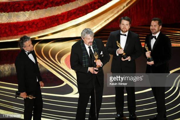 Ian Hunter Paul Lambert Tristan Myles and J D Schwalm accept the Visual Effects award for 'First Man' onstage during the 91st Annual Academy Awards...