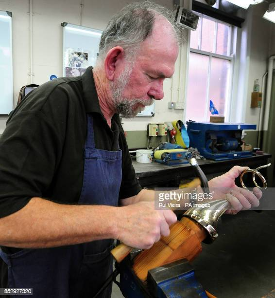 Ian in the silversmiths department hammering The Special Awards platinum which creates the texture in the body of the award for the National...