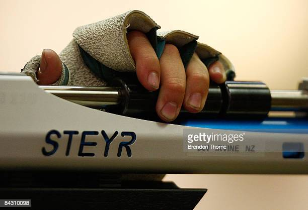 Ian Irvine of New Zealand adjusts his rifle during the Mens 10m Air Rifle during day three of the Australian Youth Olympic Festival at Sydney...