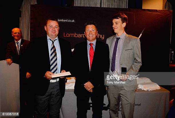 Ian Isaac Head of Lombard Sales presents the second place trophy to Edward Goodwin and James Harding of Cirencester Golf Club during the Lombard...