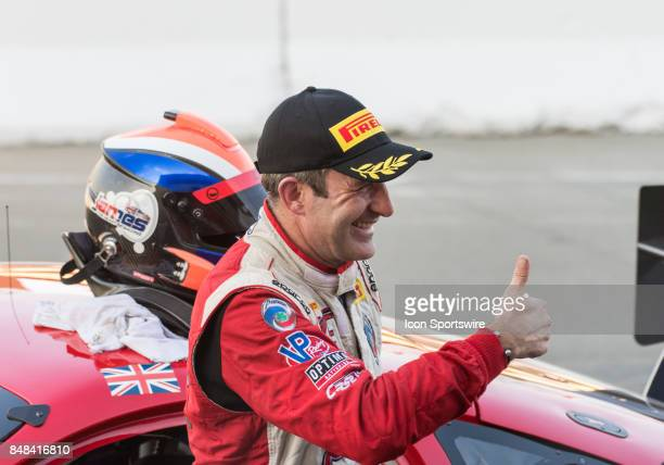 Ian James driving the Panoz Avezzano GT for Team Panoz Racing gives a thumbs up to his team after winning the World Challenge GTS Race at the Verizon...
