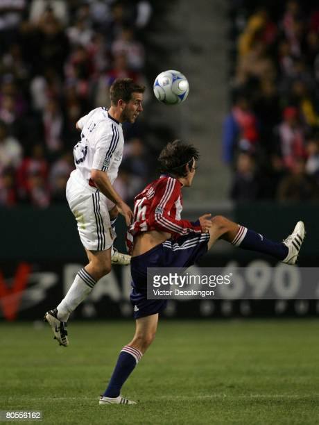 Ian Joy of Real Salt Lake heads a high ball over Sacha Kljestan of CD Chivas USA in the second half during their MLS game at the Home Depot Center on...