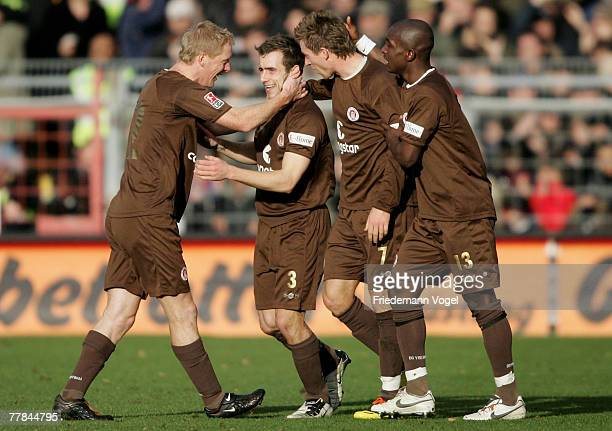 Ian Joy of StPauli celebrates scoring the first goal with Timo Schultz Marvin Braun and Charles Takyi during the Second Bundesliga match between FC...