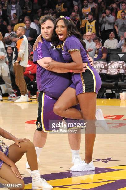 Ian Karmel and Venus Williams dance with the Laker Girls during halftime at a basketball game between the Los Angeles Lakers and the Oklahoma City...