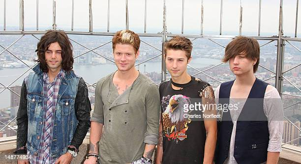 Ian Keaggy Nash Overstreet Ryan Follese and Jamie Follese of Hot Chelle Rae visit The Empire State Building on July 19 2012 in New York City