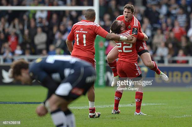 Ian Keatley of Munster celebrates withJJ Hanrahan after kicking the match winning drop goal during the European Rugby Champions Cup match between...