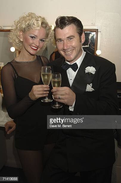 Ian Kelsey celebrates with Jennifer Ellison who returns to the 'Chicago' musical as 'Roxy Carter' at the Cambridge Theater on July 10 2006 in London...