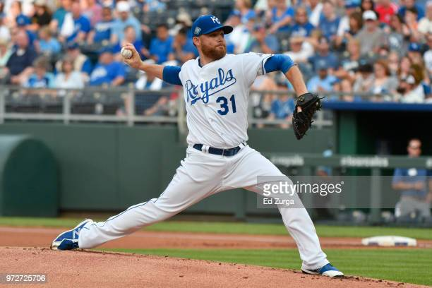 Ian Kennedy of the Kansas City Royals throw in the first inning against the Cincinnati Reds at Kauffman Stadium on June 12 2018 in Kansas City...