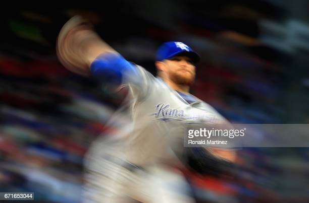 Ian Kennedy of the Kansas City Royals throws against the Texas Rangers in the second inning at Globe Life Park in Arlington on April 22 2017 in...