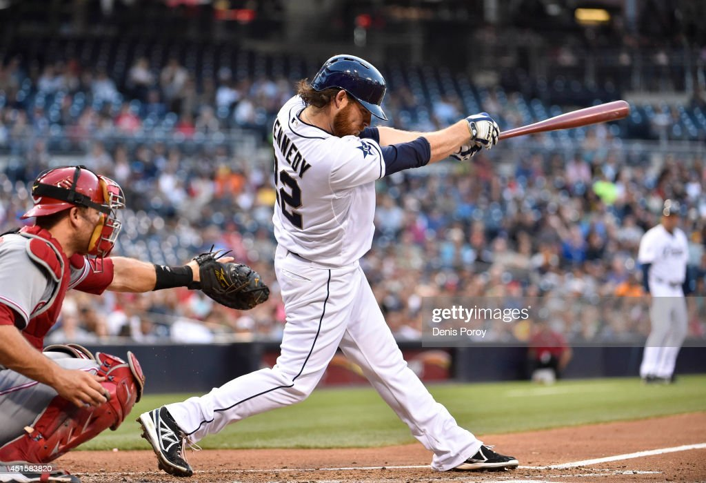 Ian Kennedy #22 of the San Diego Padres hits an RBI single during the second inning of a baseball game against the Cincinnati Reds at Petco Park July 1, 2014 in San Diego, California.