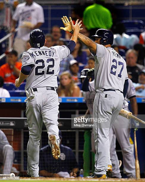 Ian Kennedy of the San Diego Padres is congratulated by Matt Kemp after scoring during a game against the Miami Marlins at Marlins Park on July 31...