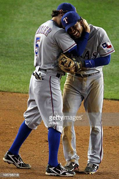 Ian Kinsler and Elvis Andrus of the Texas Rangers celebrate afte the Rangers won 103 against the New York Yankees in Game Four of the ALCS during the...